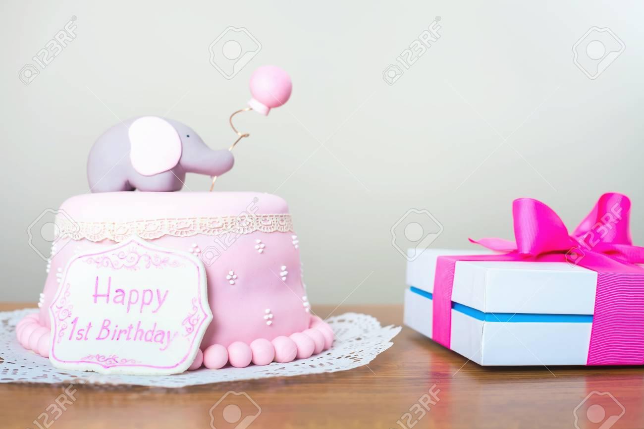Celebrating First Birthday Cake And Gift Happy 1st Birsday