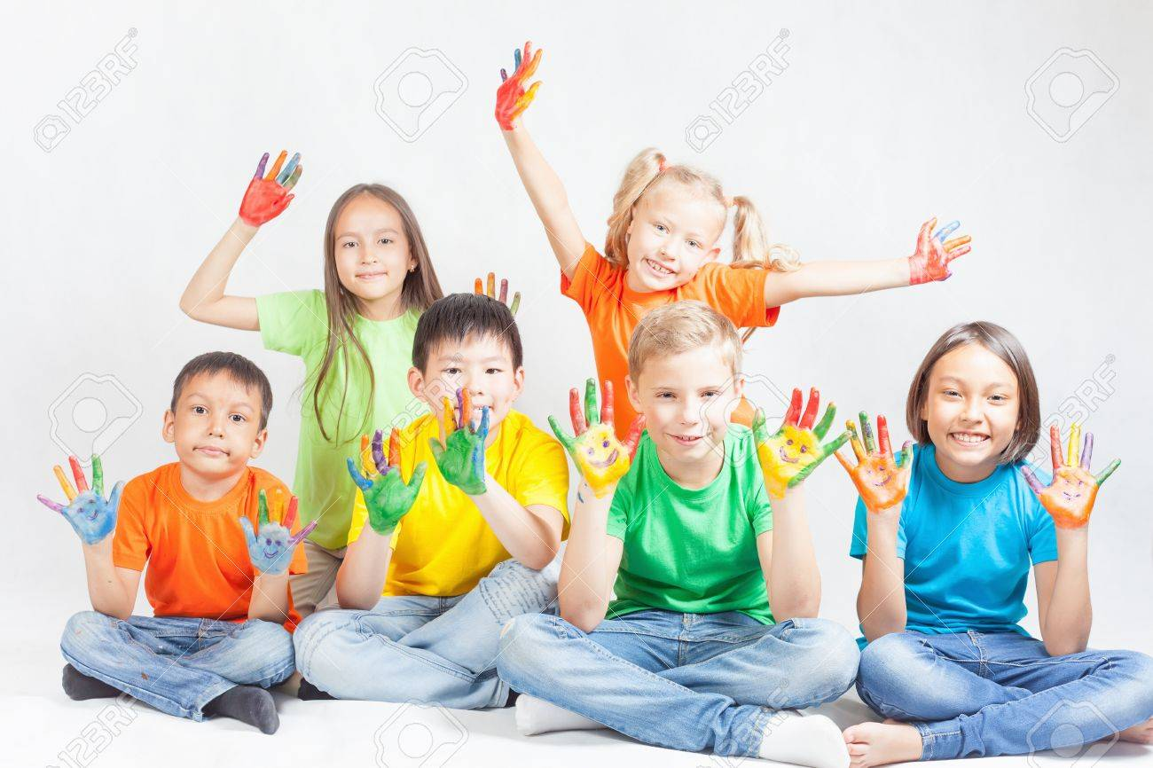 Happy kids with painted hands smiling and posing at white background. Funny children. International Children's Day. Indian, asian, caucasian - multiracial ethnicity - 56824871