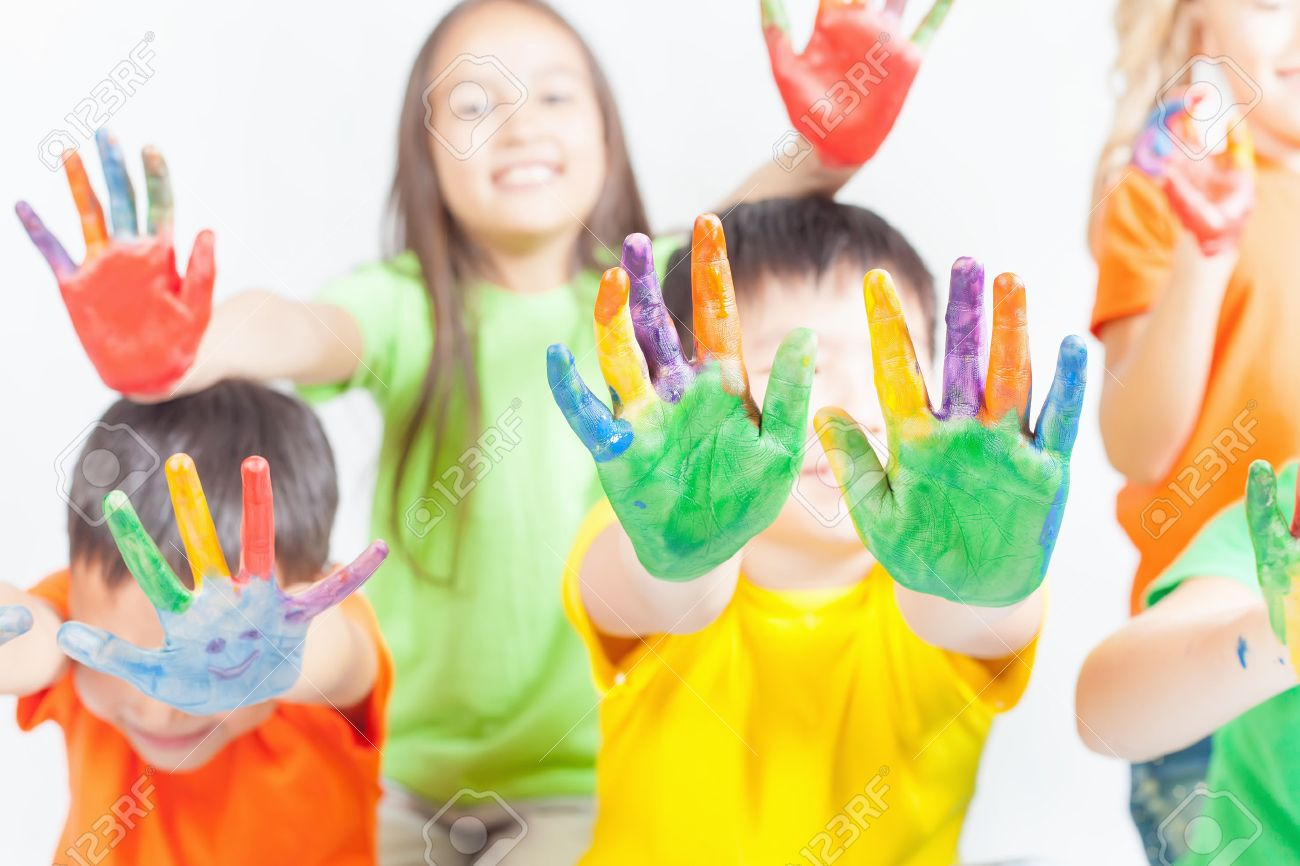 Happy kids with painted hands on a white background. International Children's Day. Painting, occupation - 56824872