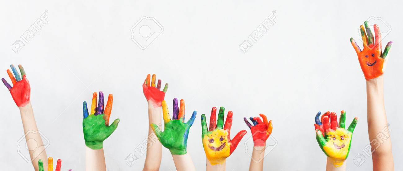 lot of painted hands raised up group of multiracial funny children