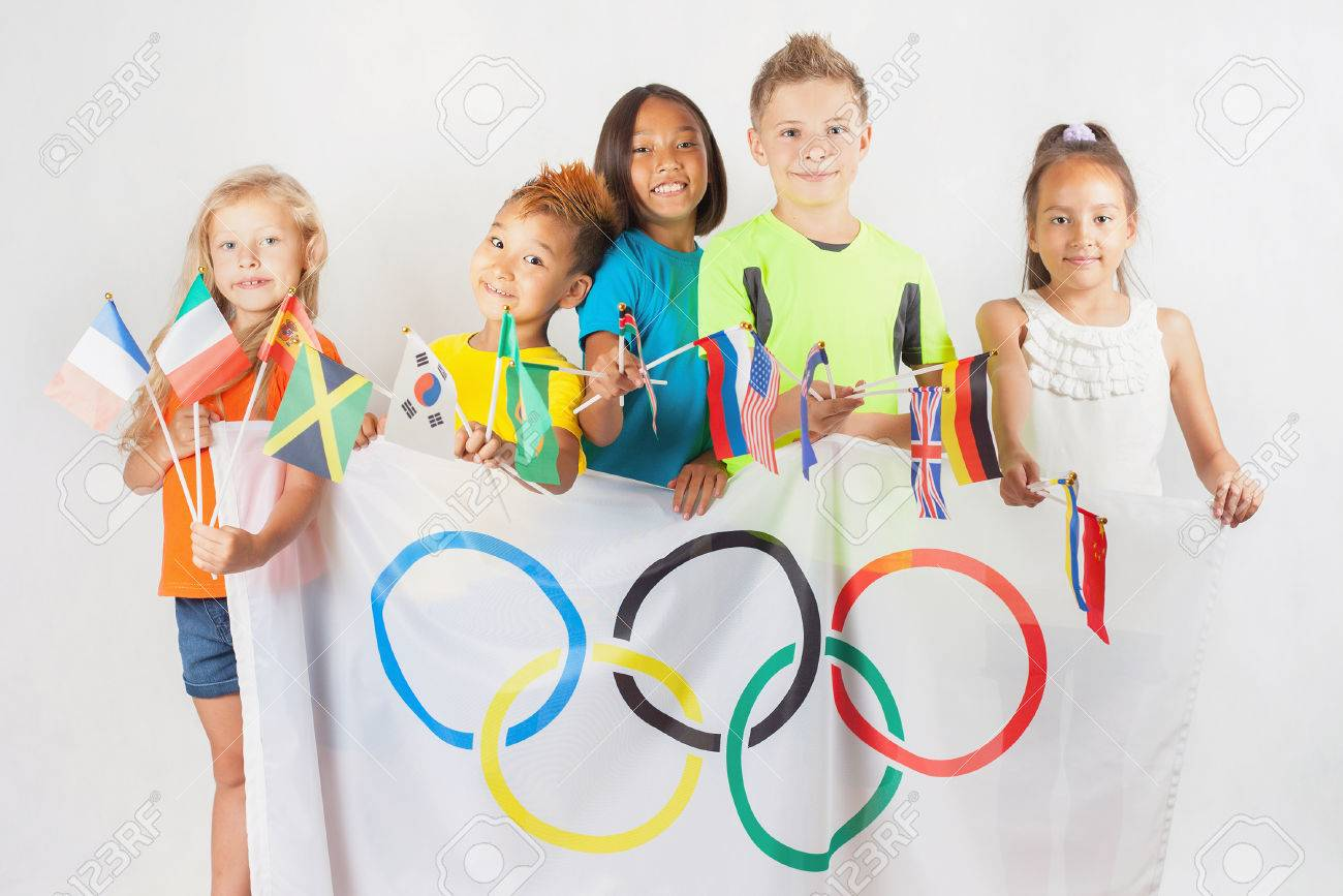 Rio de janeiro brazil july 17 2016 group of children holding rio de janeiro brazil july 17 2016 group of children holding a flag of five rings symbol of olympic games and international flags biocorpaavc Images