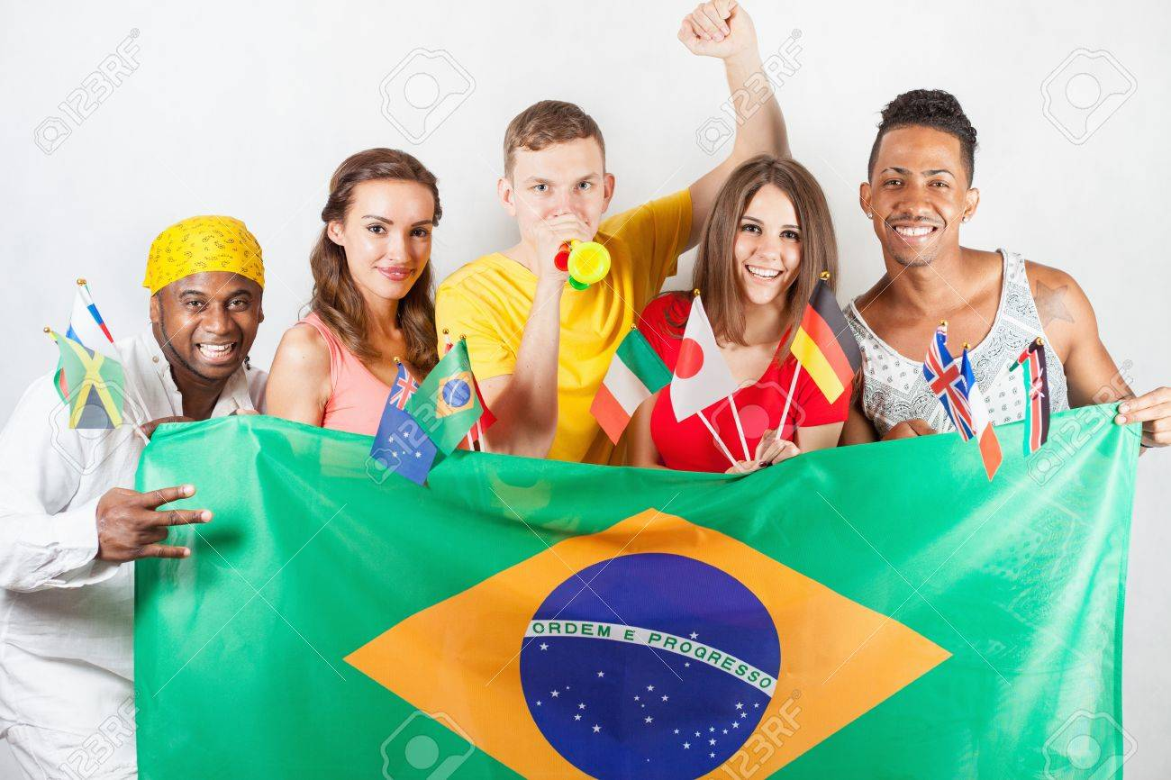 Group Of Multiracial People Holding A Brazil Flag And ...
