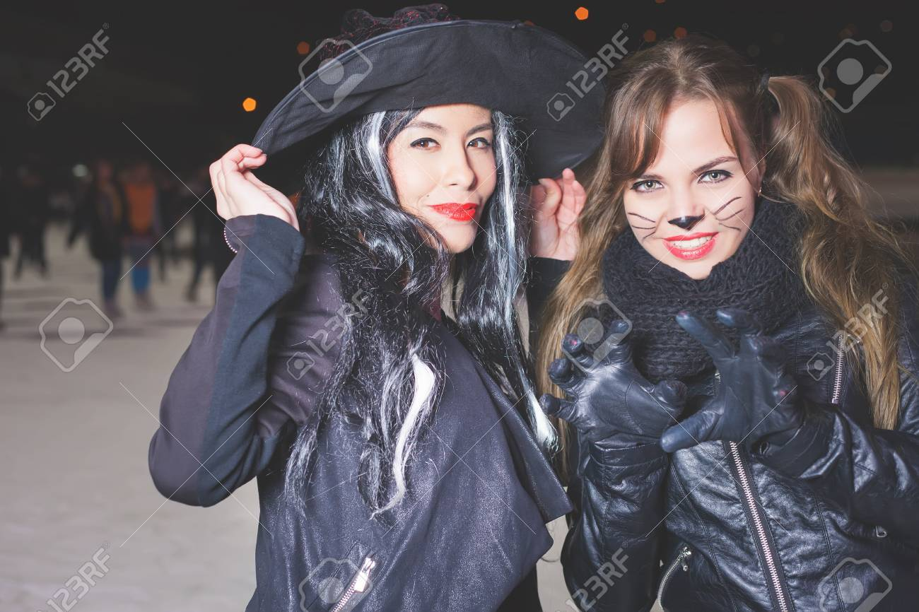 Halloween Party! Young Women Like Witch And Cat Role. Cat And ... 3948faccf62