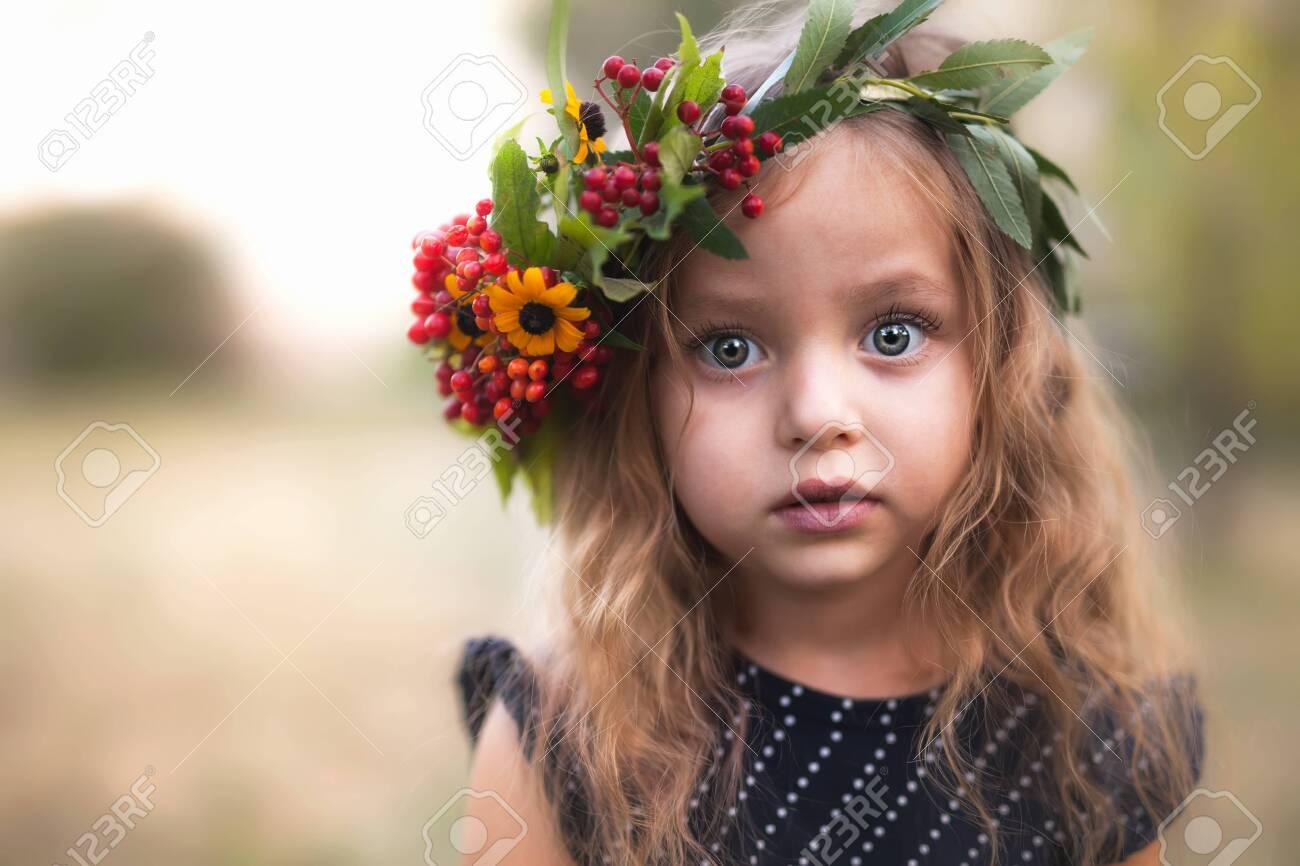 Summer outdoor portrait of beautiful happy child - 121196190
