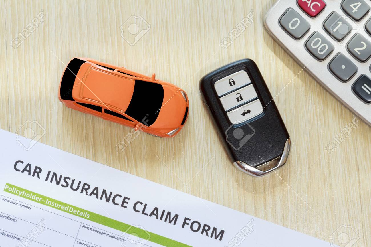 Car Insurance Concept With Car Toy, Car Key And Calculator Lay Down On  Wooden Desk