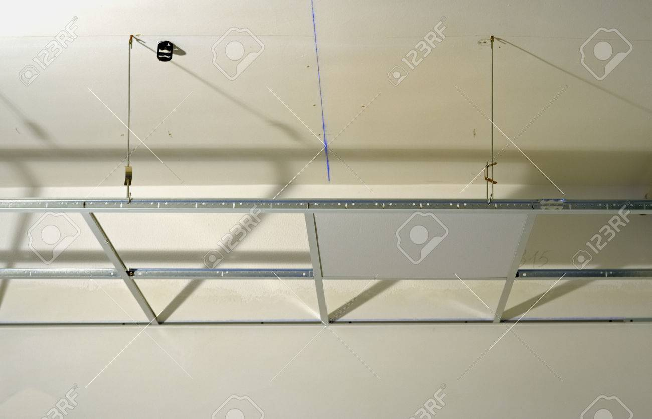 Construction of the structure of a suspended ceiling with construction of the structure of a suspended ceiling with plasterboard stock photo 44579993 dailygadgetfo Image collections
