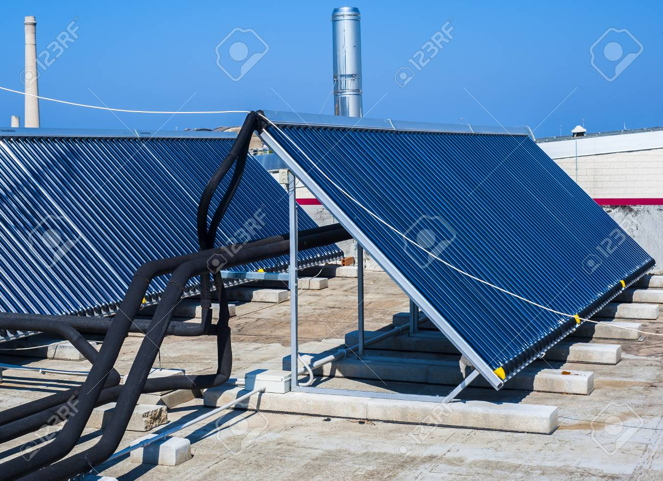 Vacuum Solar Cells For Water Heating System On The Pool Roof Stock Home Panels Power Photo