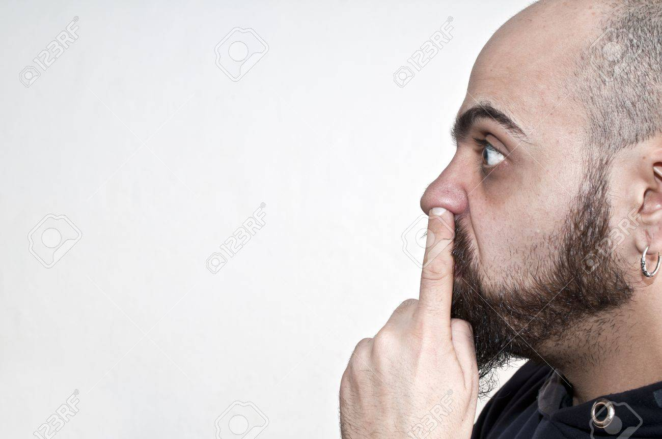 man with his finger in the nose on white background Stock Photo - 8966187