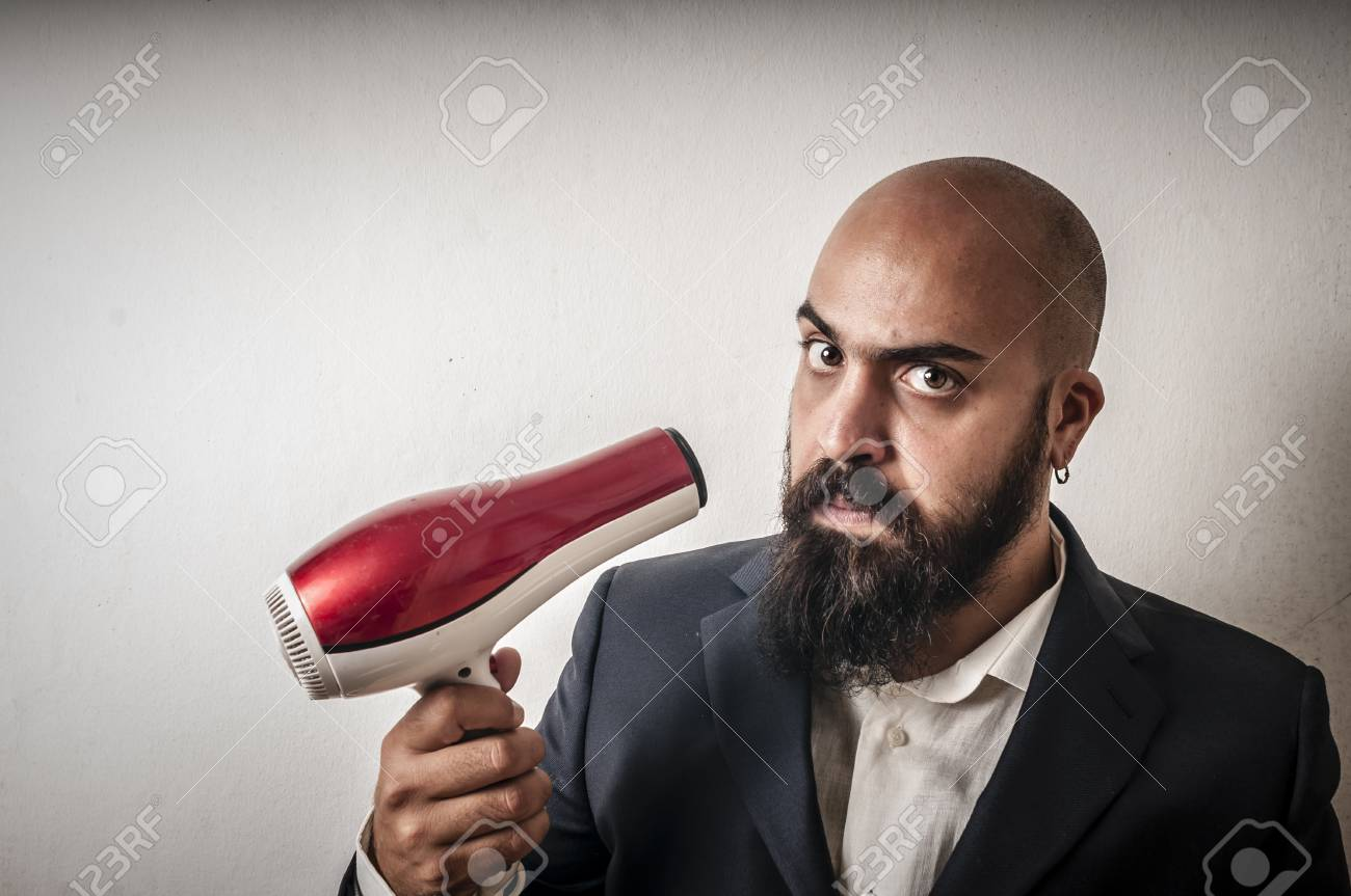 man bearded and jacket with hairdraier and funny expressions on white background Stock Photo - 15355238