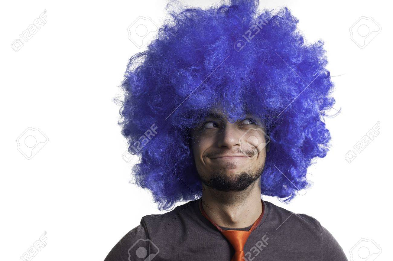 Crazy guy with blue wig on white background Stock Photo - 15482981