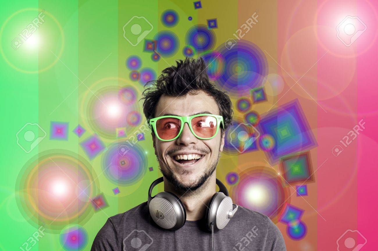 Crazy guy with headphones on colorful background Stock Photo - 15482971