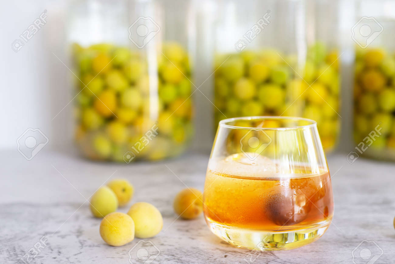 'Umeshu' on rock, a glass of Japanese plum wine 'Umeshu' with iced. - 158872861