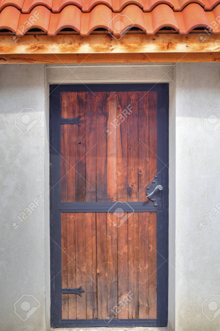 Stock Photo - Stylish wooden door with metal ornaments & Stylish Wooden Door With Metal Ornaments Stock Photo Picture And ...