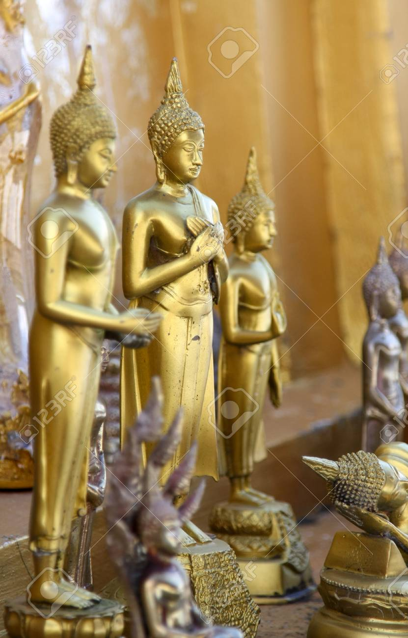 Standing gold buddha statues in a temple, Thailand Stock Photo - 17346560
