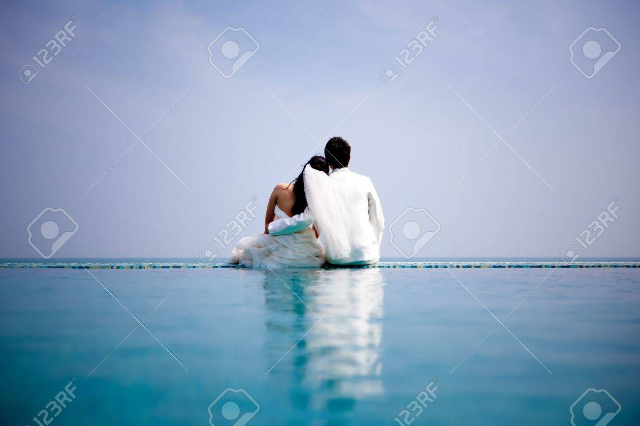 In love bride and groom are posing in romantic emotion - 18349352