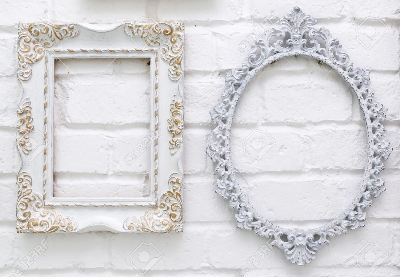 Vintage Picture Frames On White Brick Wall Background Stock Photo ...