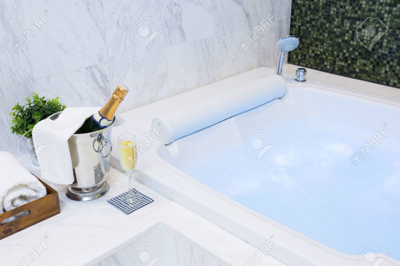 Champagne Glass And Jacuzzi Spa With Colourful Light Whirlpool Stock ...