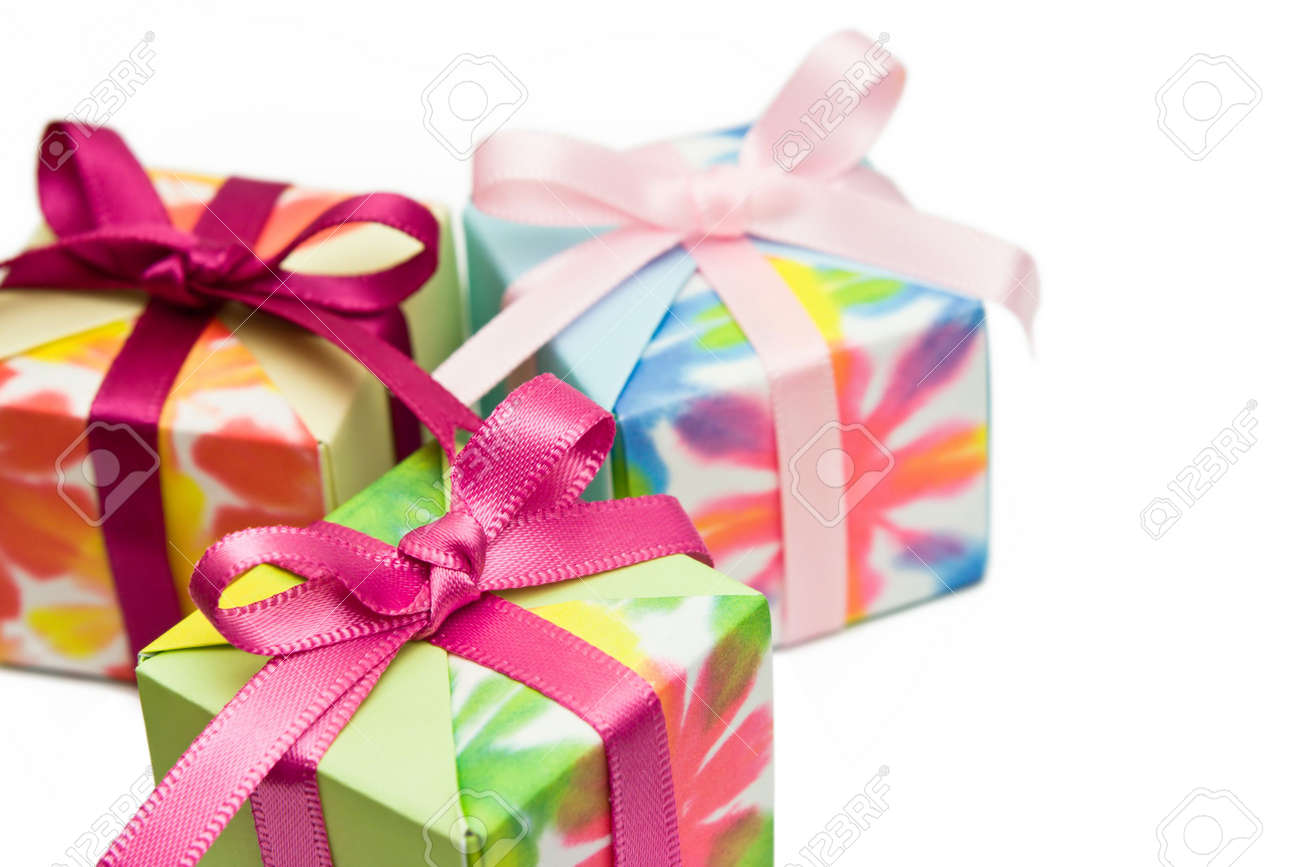 Three origami gift boxes on a white background. Focus on the pink ribbon of the box in front. Stock Photo - 3299882
