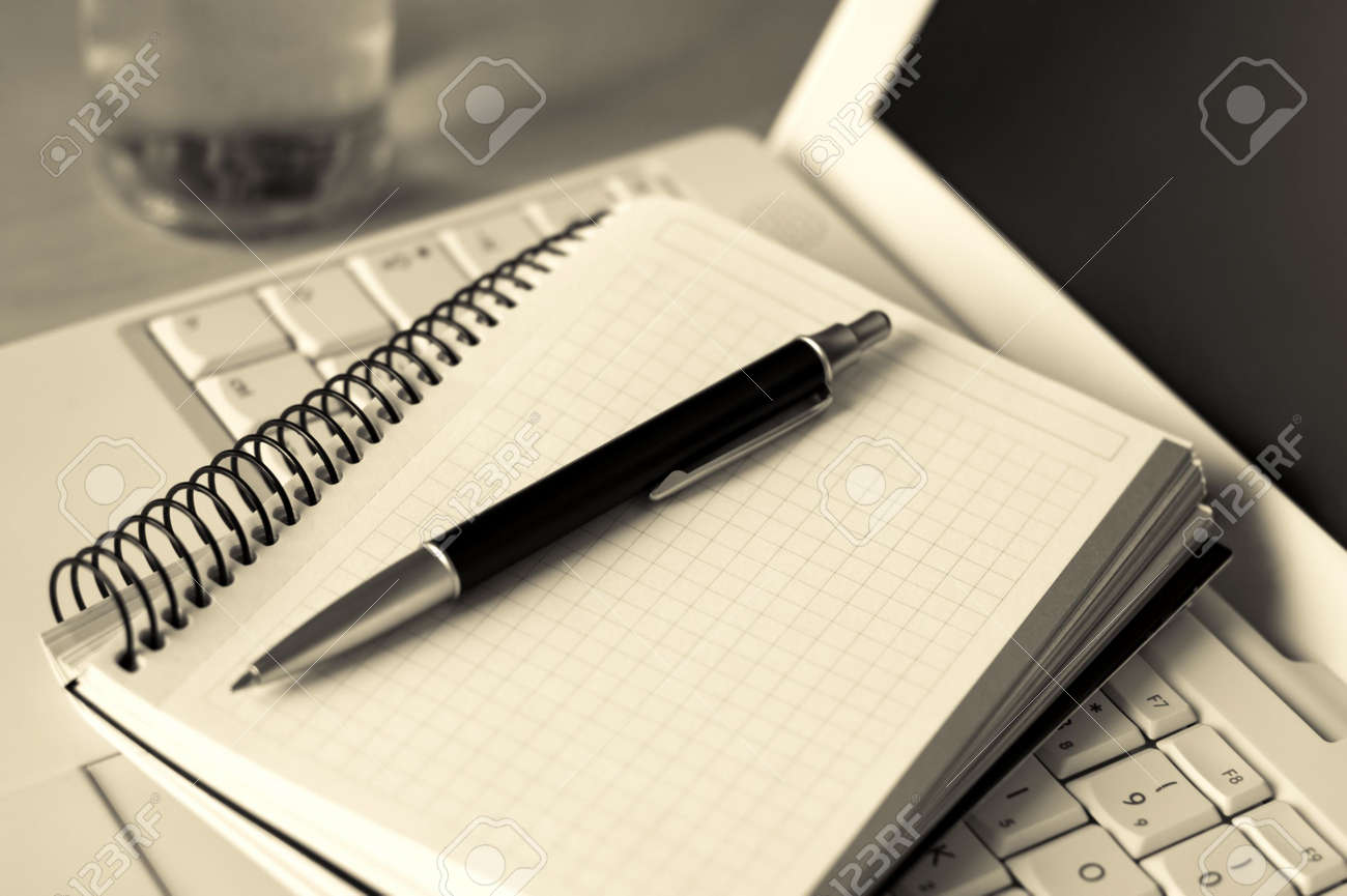 Photo of a laptop, pen, notebook and a glass of water, things that you often see in seminars and meetings. Stock Photo - 3348982
