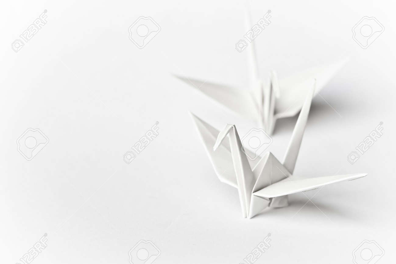 Two origami birds on a white background Stock Photo - 3610409