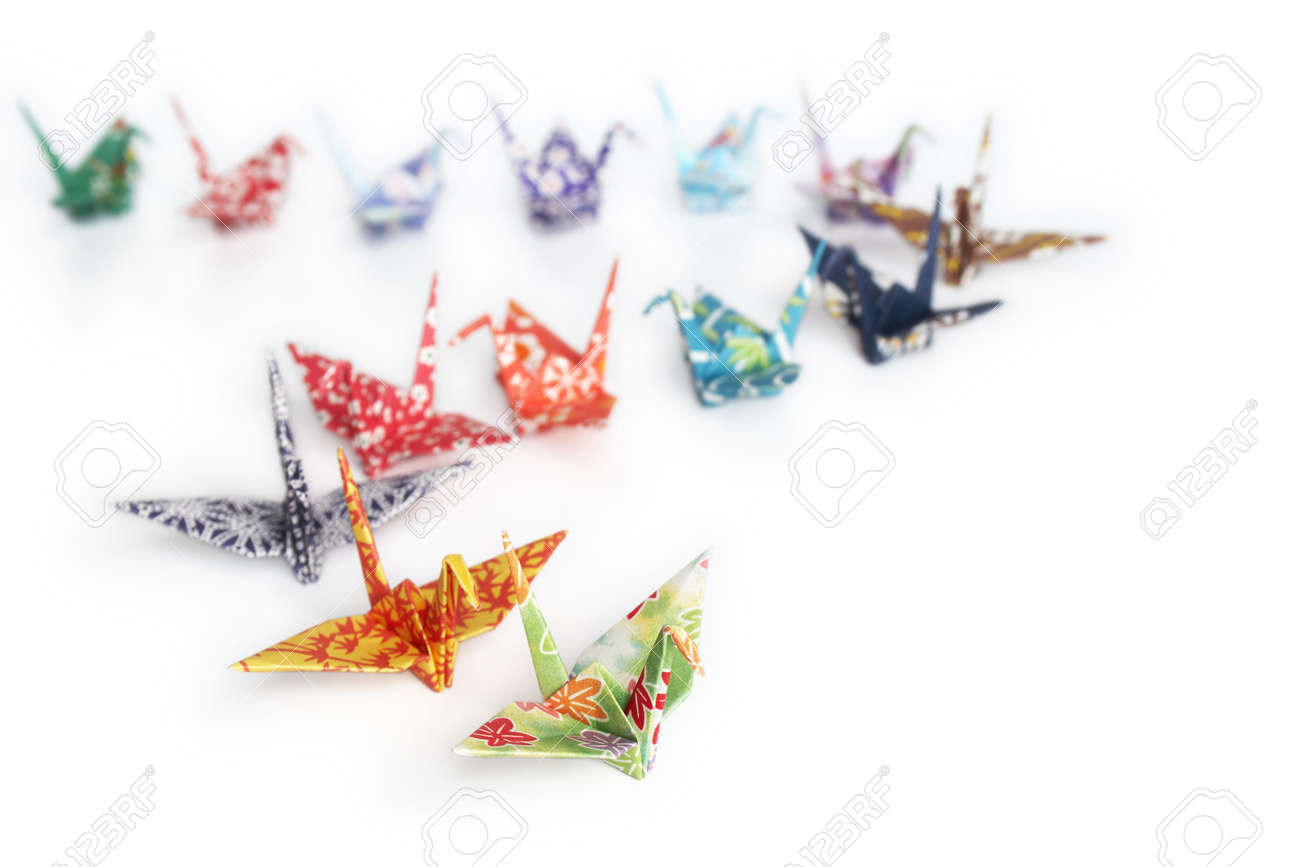 A queue of origami birds on a white background Stock Photo - 3610423