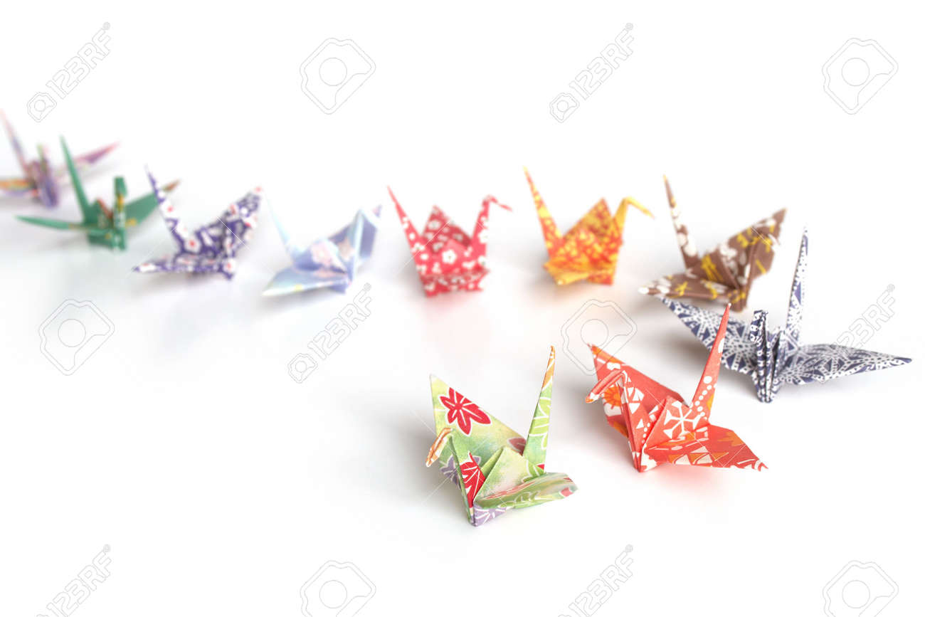 A queue of colourful origami birds on a white background Stock Photo - 3610416