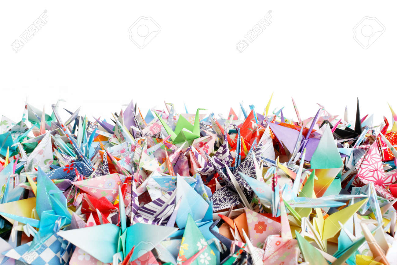 Close up of a pile of origami birds on a white background Stock Photo - 5540865
