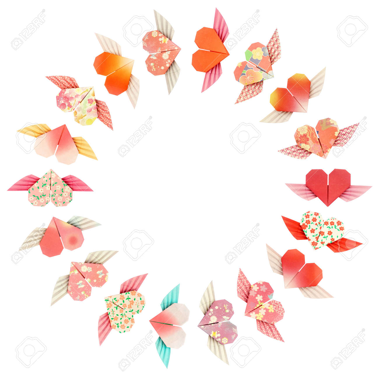 Paper folded winged-hearts arranged in a circle shape, isolated on a white background Stock Photo - 6357155