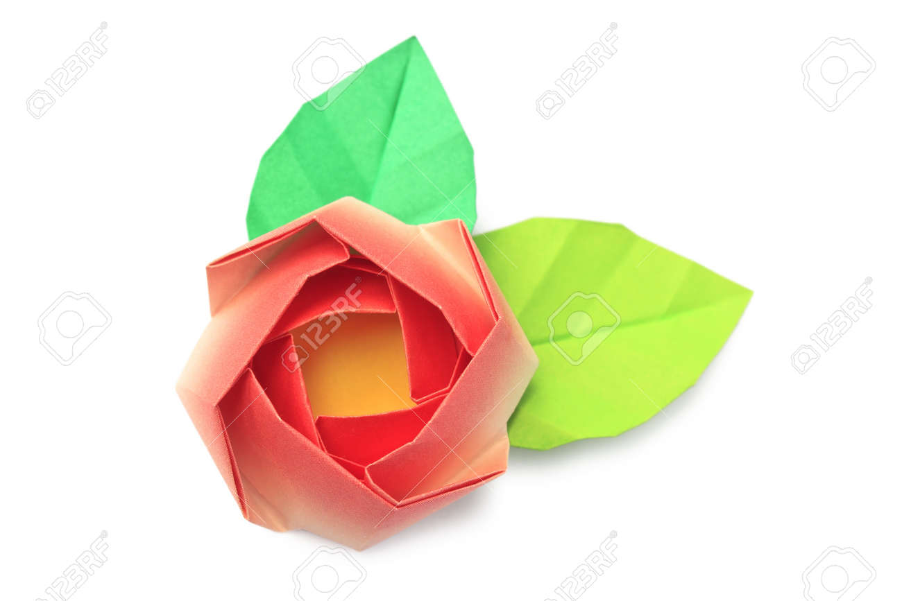 A red paper rose with two leaves on a white background Stock Photo - 9038393
