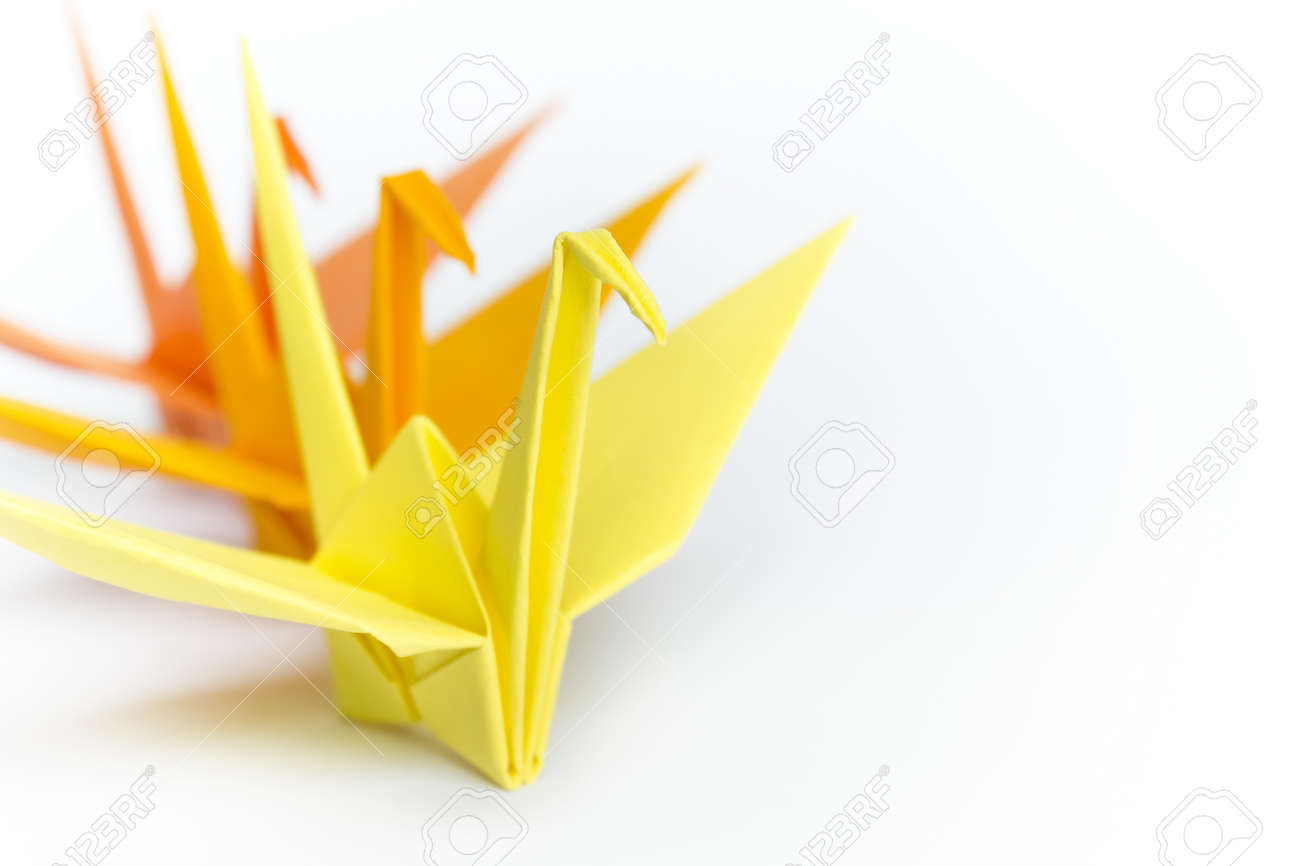 Three paper birds lining up on a white background, shallow depth of field Stock Photo - 9211469