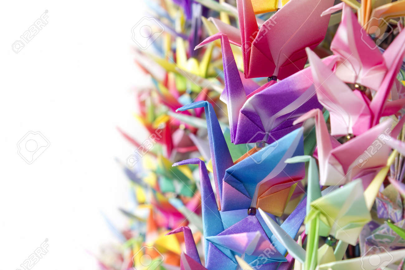 Colourful paper birds hanging together using fishing lines. Shallow depth of field. Stock Photo - 9288989