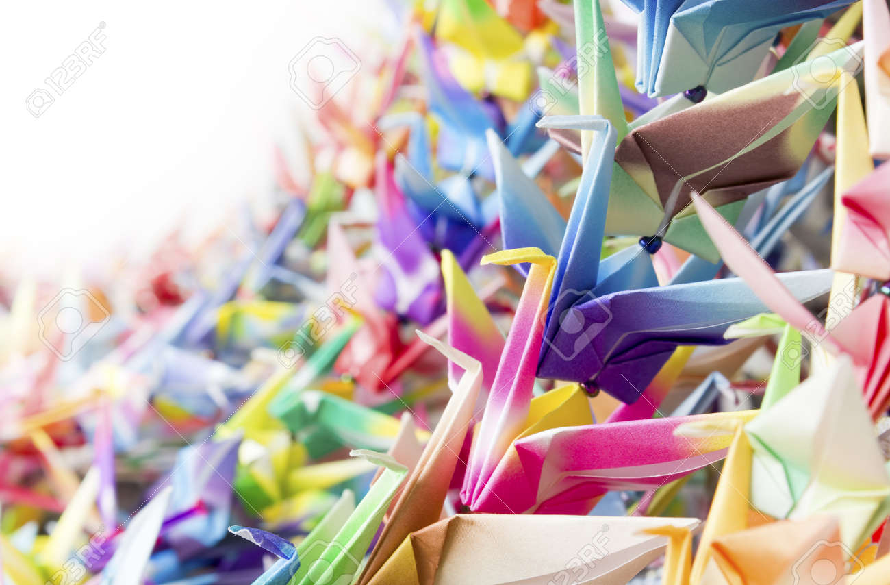 Colourful paper birds hanging together using fishing lines. Shallow depth of field. Stock Photo - 9288992
