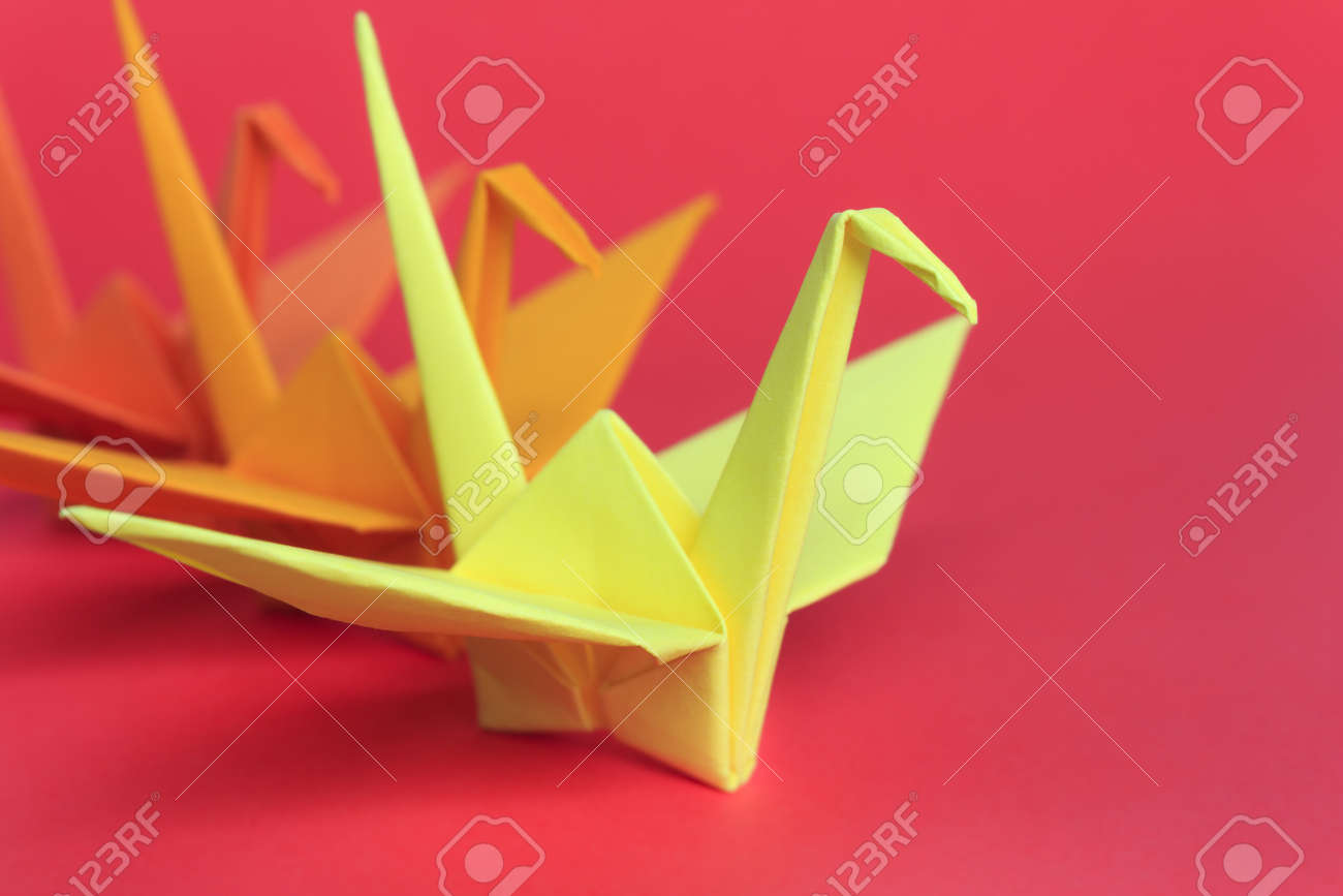 Three paper birds on a red background, shallow depth of field Stock Photo - 13530701