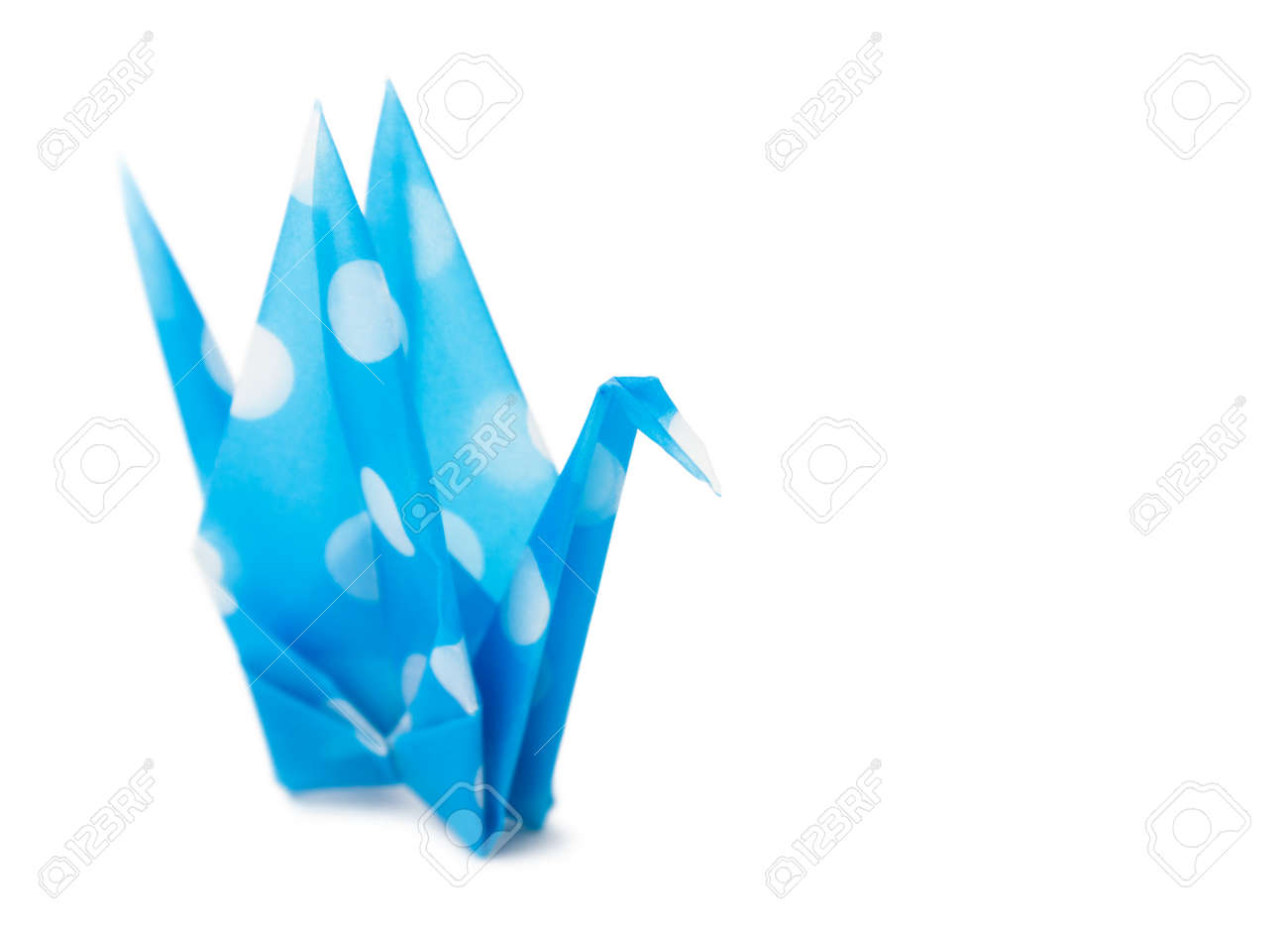 Semi-transparent cyan paper crane on white background. Very shallow depth of field. Stock Photo - 31833212