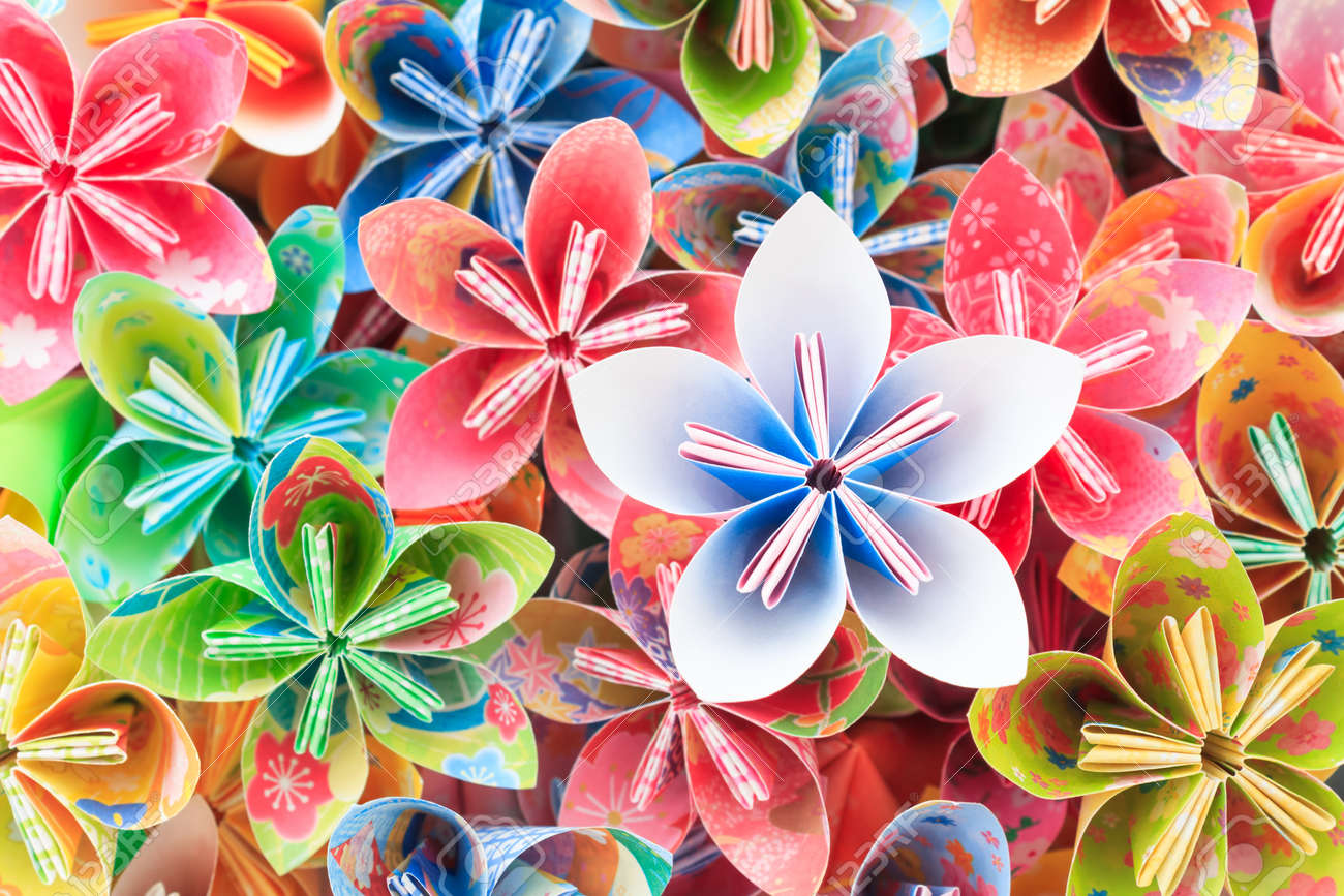 A pile of colourful Japanese Kusudama flower pieces. Shallow depth of field. Focus on the blue/pink flower on top of the pile. Stock Photo - 32711459