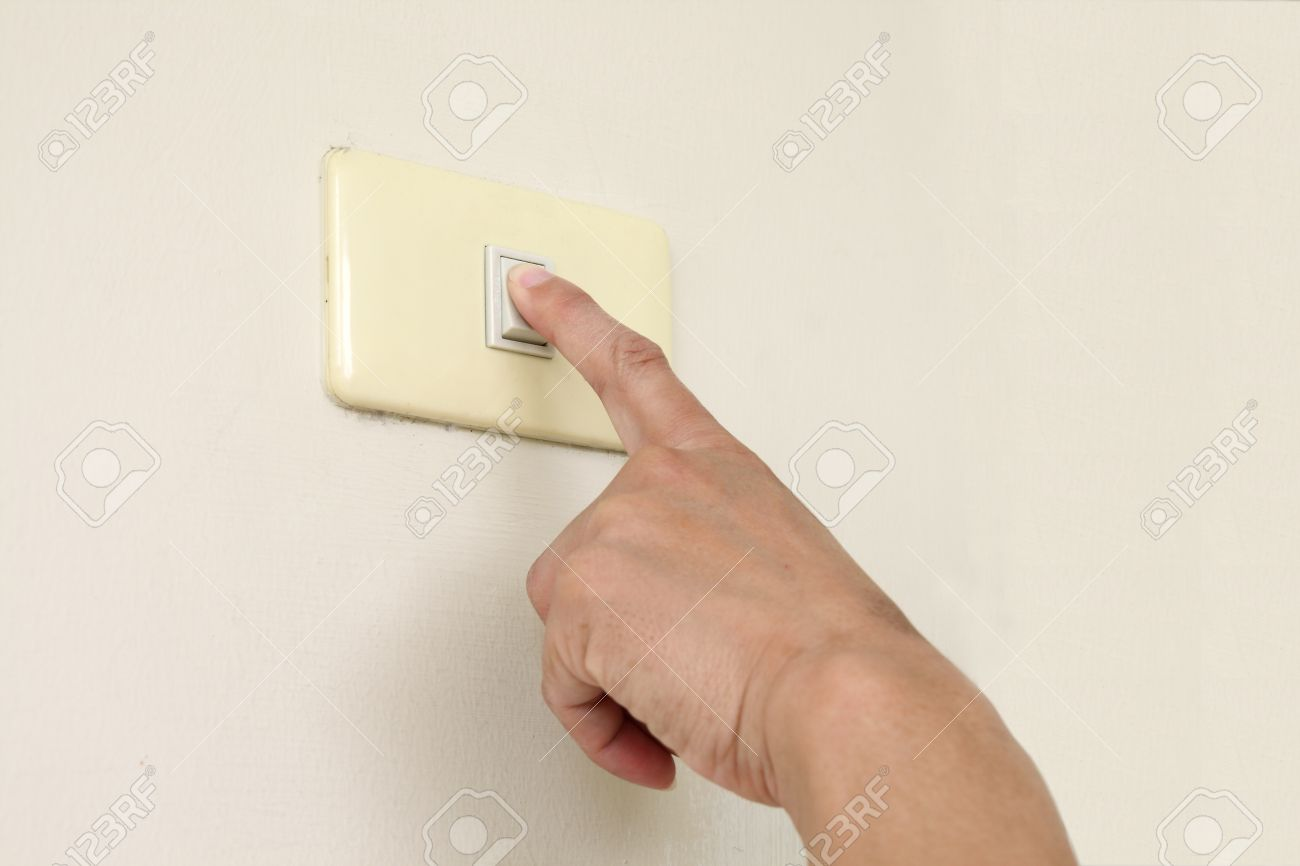 Finger turning off or turning on the wall-mounted light switch Stock Photo - 9514451
