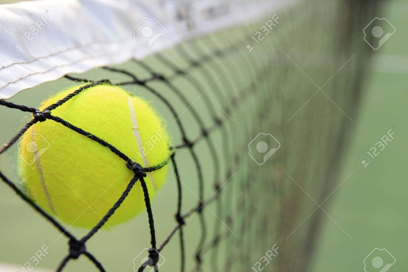 Tennis ball in net Stock Photo - 11647415