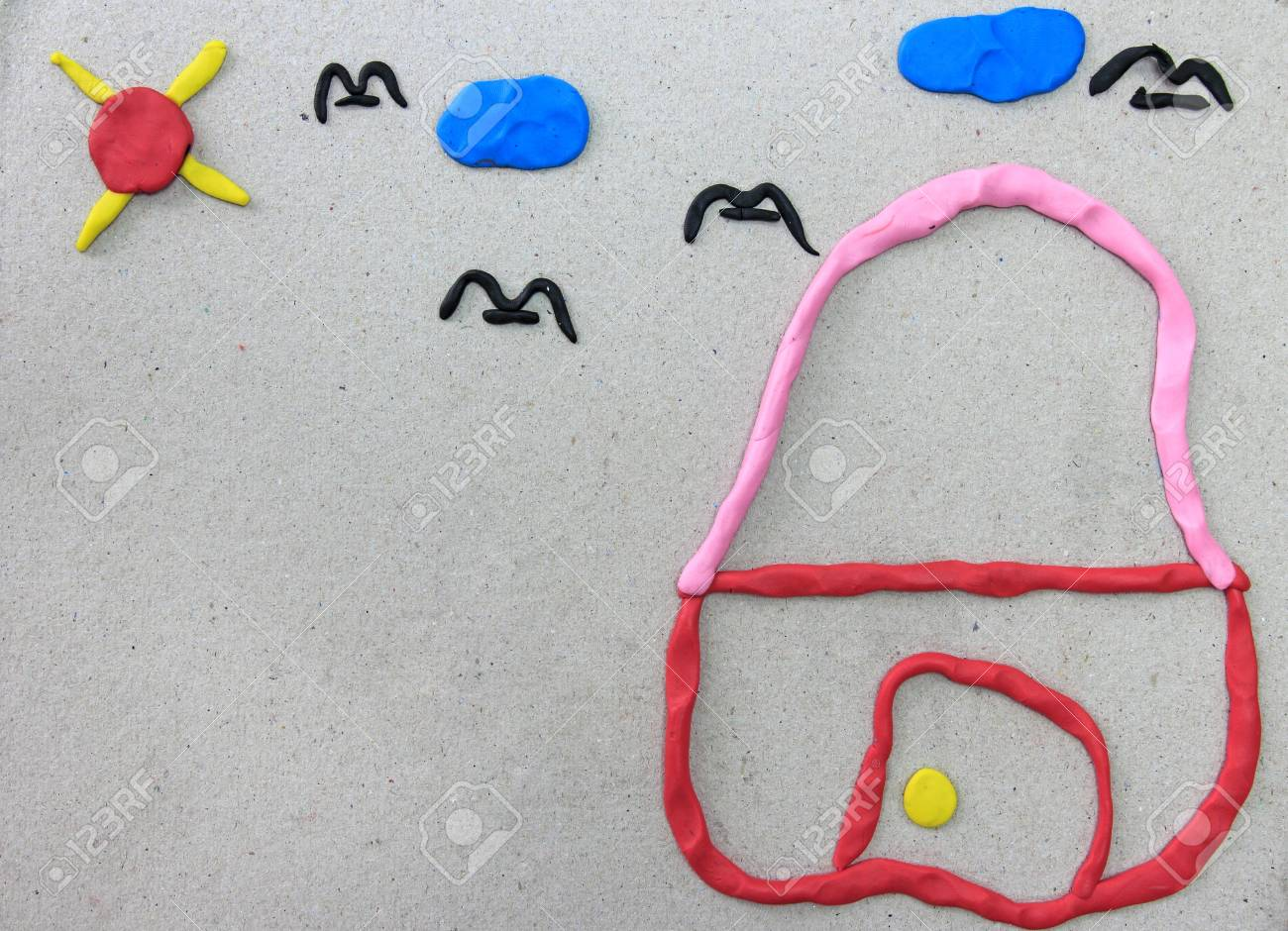 My home made from plasticine on recycle paper Stock Photo - 12073686