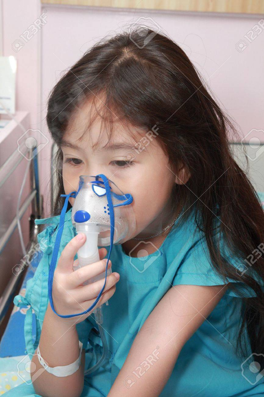 Little girl with a mask for inhaler in hospital - 16253626