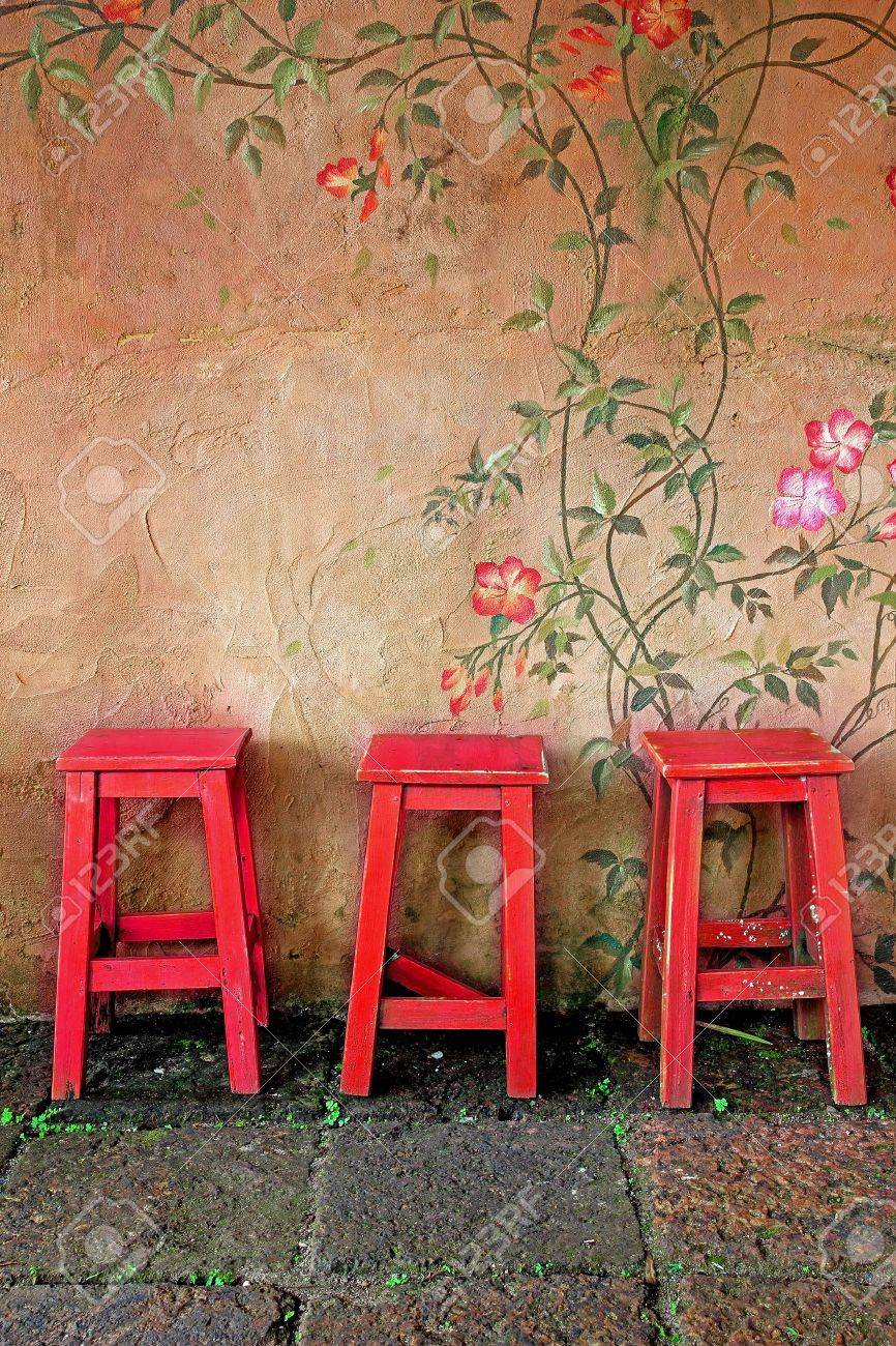 old vintage wooden chair and wall - 17487063