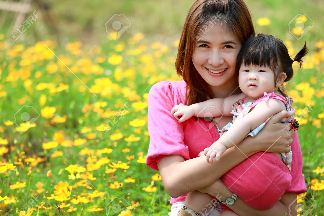 Mother and daughter in the park - 18768085