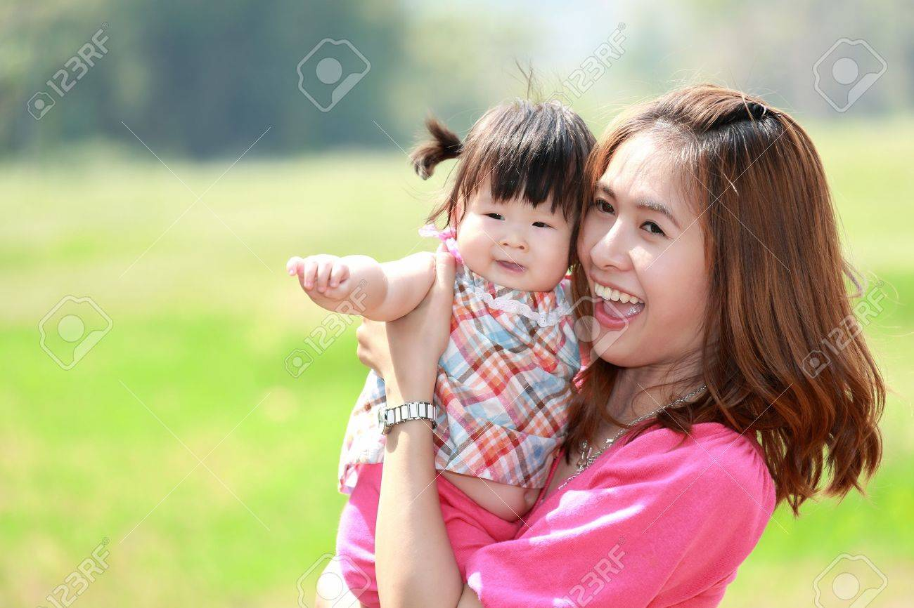 Mother and daughter in the park Stock Photo - 18768079