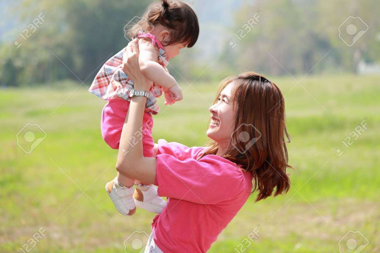 Mother and daughter in the park - 18768075