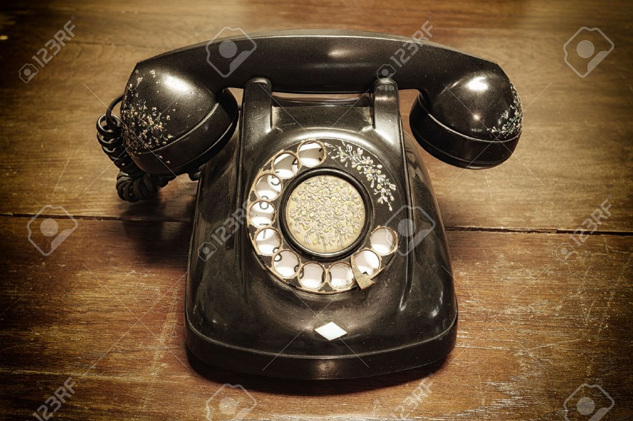 old telephone with rotary dial on old wooden Stock Photo - 20494561