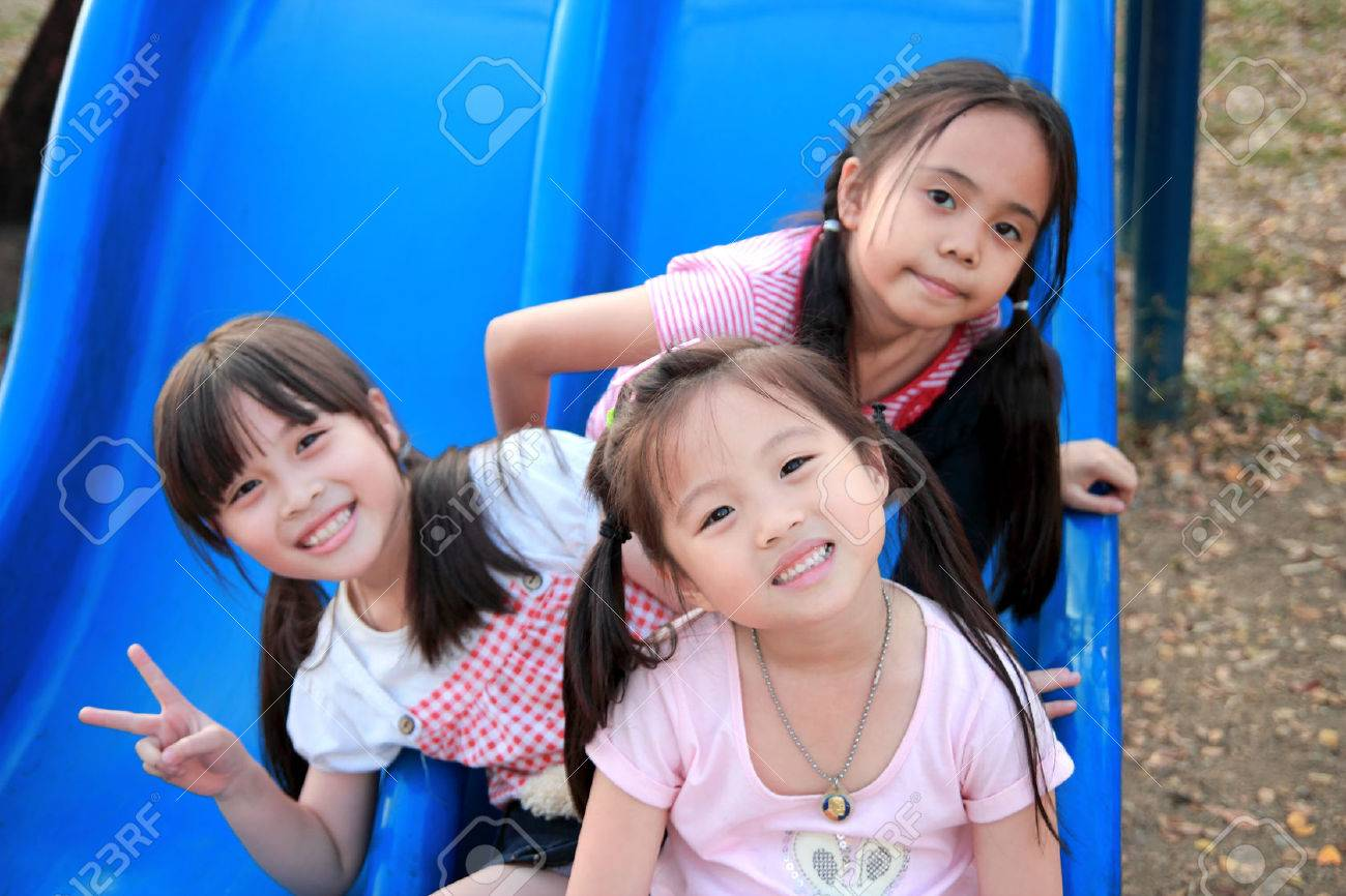 Three happy smiling children playing in park - 26160035