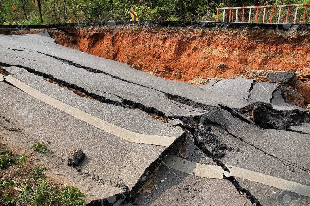 Crack of asphalt road after earthquake - 32123899