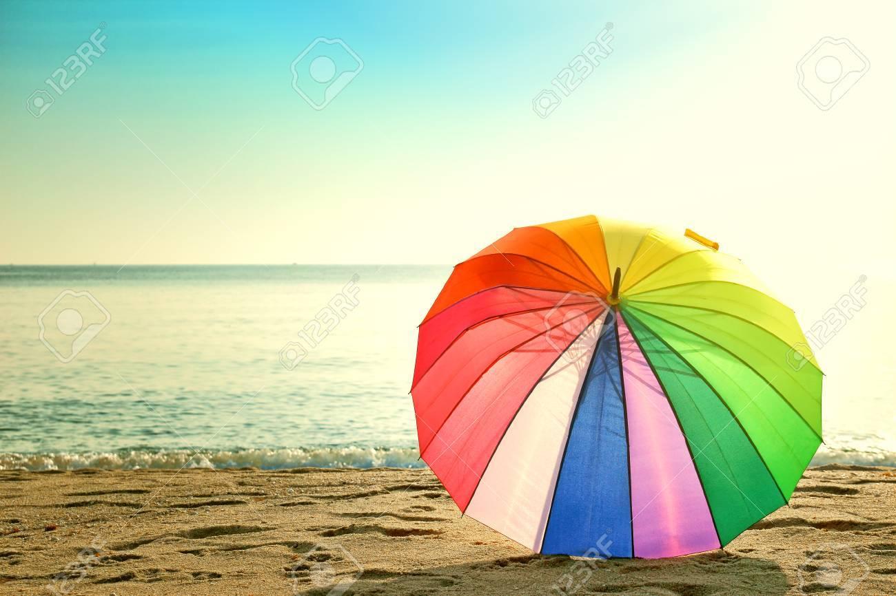 Colourful umbrella on the beach retro style - 45730723