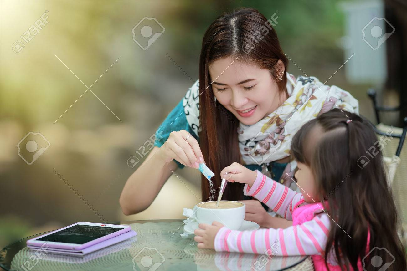 Young mother relaxing together with her little child girl in summer outdoors - 47486707