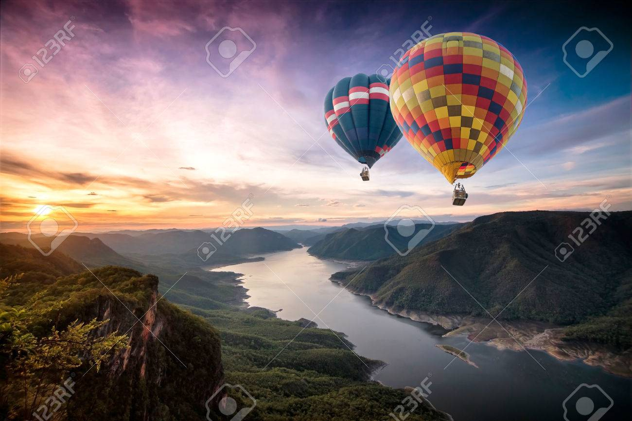 Colorful hot air balloons flying over on Mae Ping National Park at sunrise - 54601125
