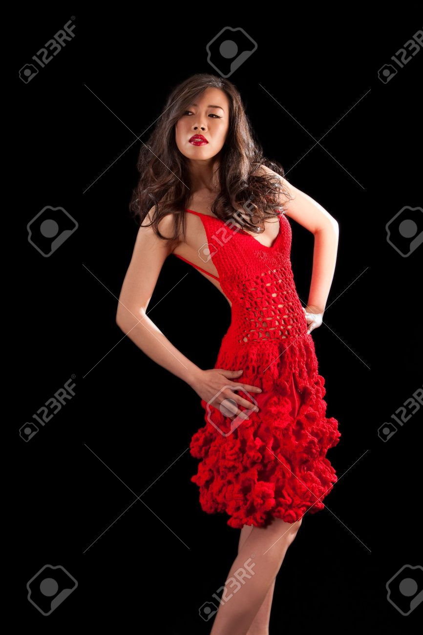 701da02e758 Beautiful sexy Asian woman in a crochet red dress, isolated